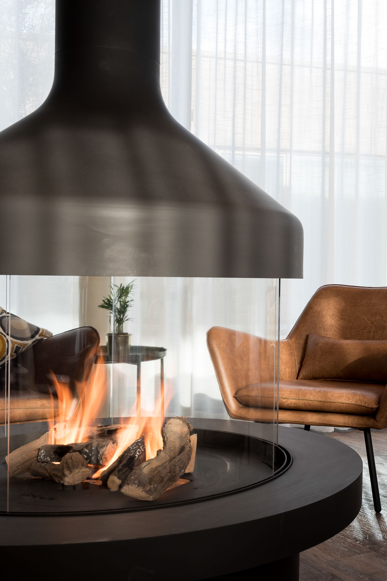 Cosy fireplace at PREMIER SUITES PLUS Antwerp